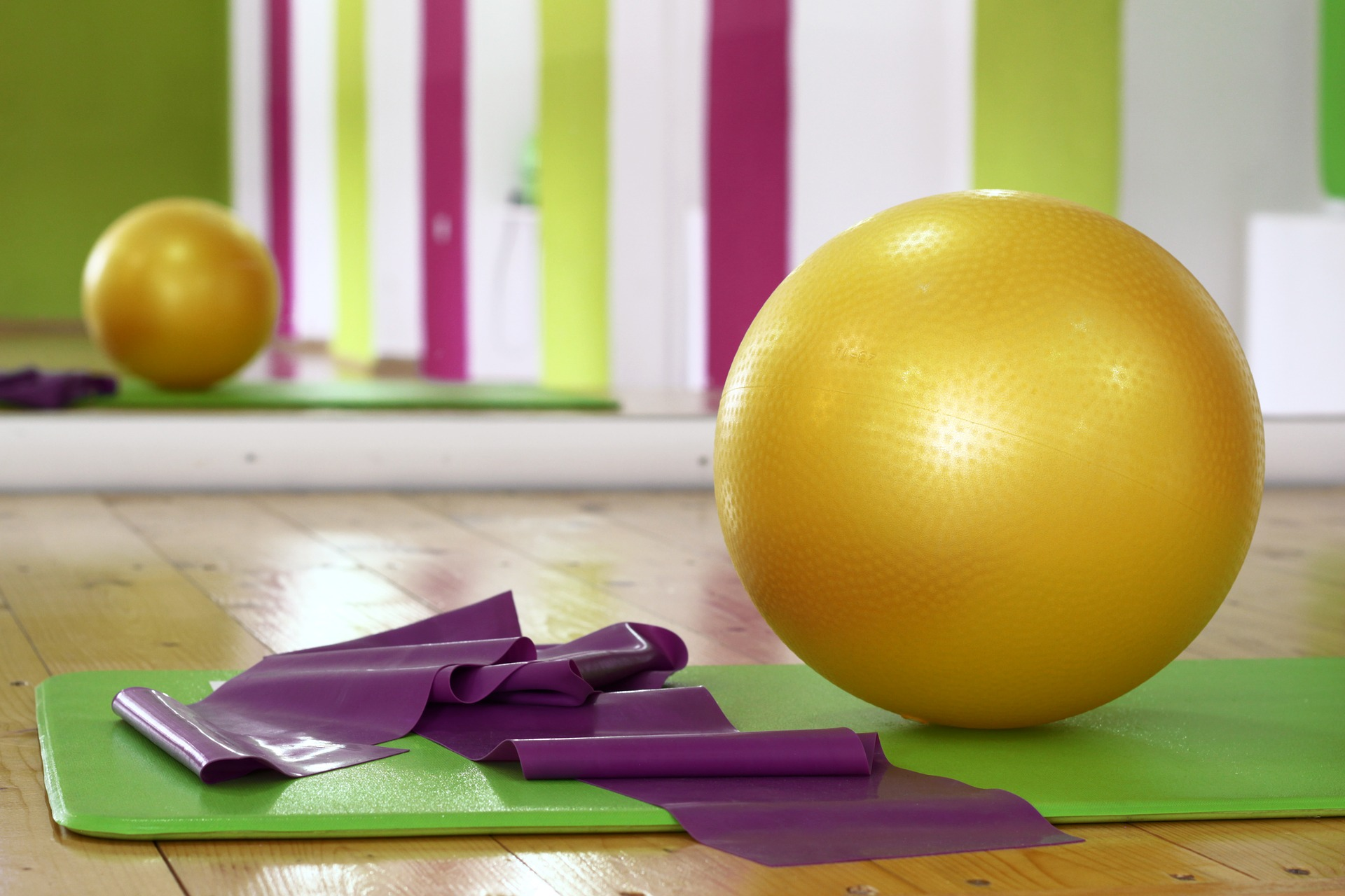 Yoga mat, strap and ball ready for yoga class offered as an alternative employee benefit