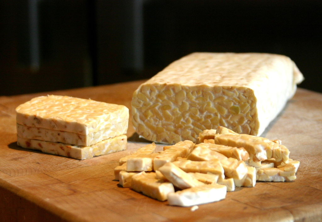 Sliced tempeh on cutting board