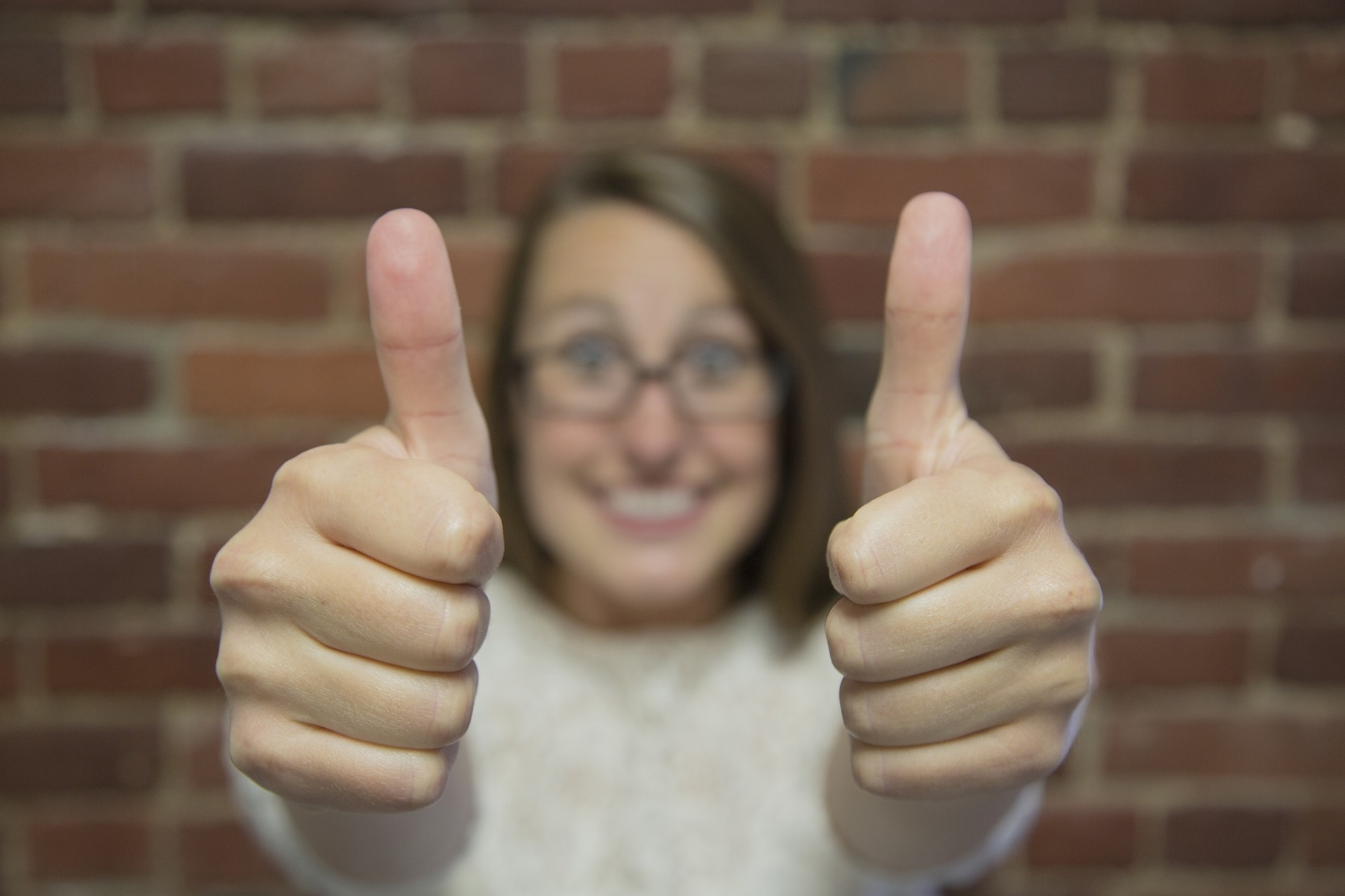 Happy woman giving two thumbs up