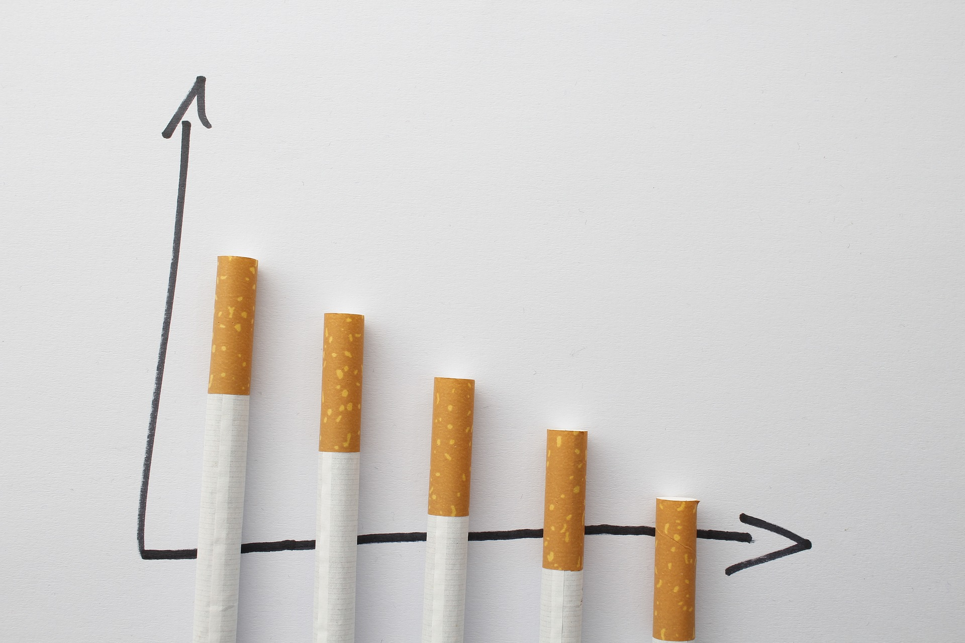 Cigarettes arranged on line graph to indicate process of quitting smoking