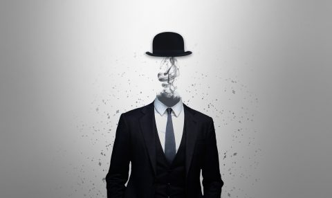 Image of a man in a suit with smoke where his head should be