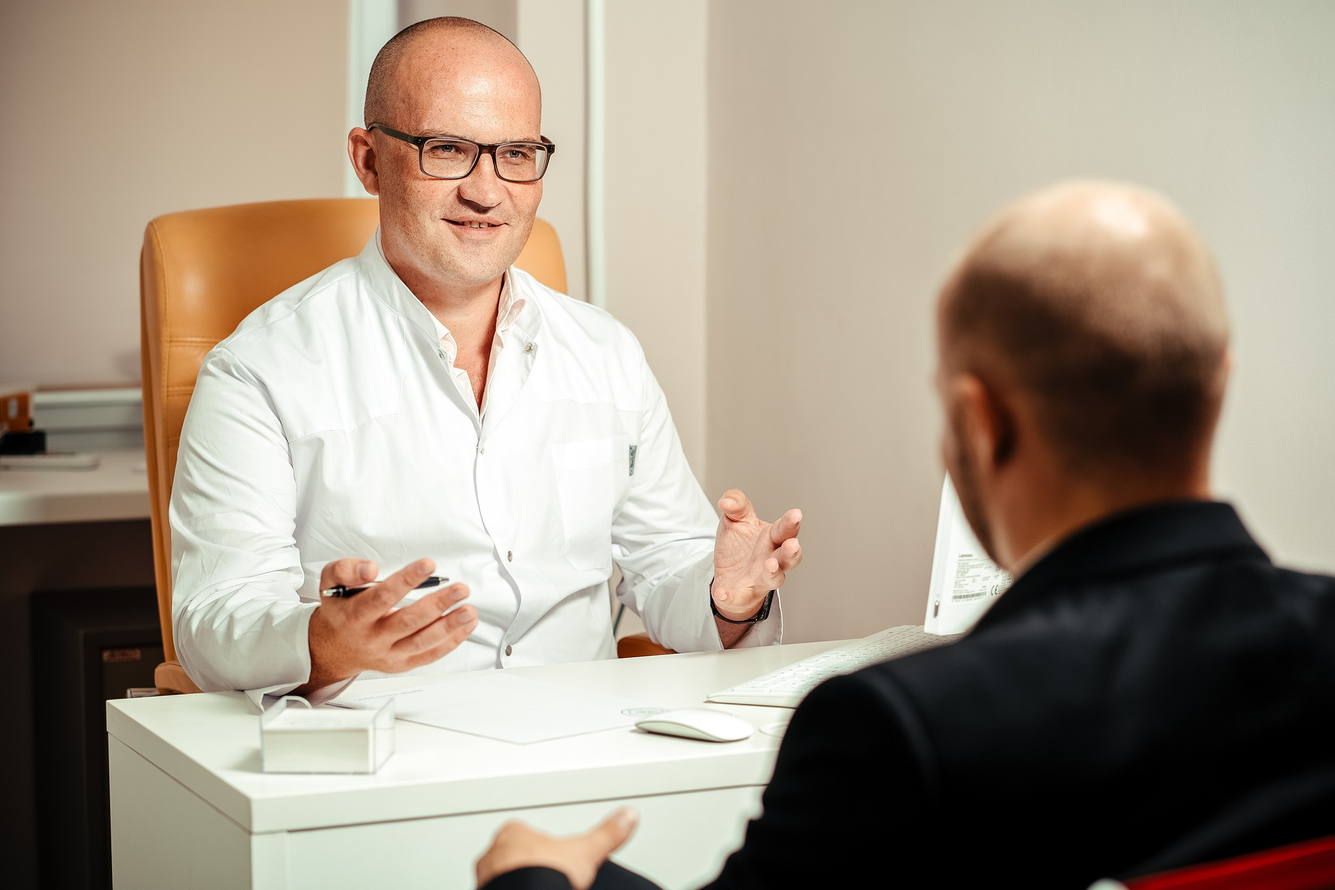 Doctor sitting at desk for consultation with client